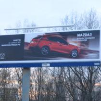Winyl Frontlite na tablicach 12x3m. Stroeer. Projekt zrealizowany dla Mazda Polska, Dom Mediowy MEC